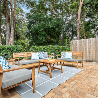 Inspiration for a beach style backyard patio in Other with brick pavers and no cover.