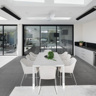 Inspiration for a large contemporary backyard patio in Melbourne with an outdoor kitchen, concrete slab and a roof extension.