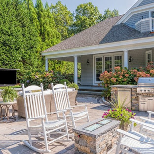 Inspiration for a mid-sized timeless backyard concrete paver patio kitchen remodel in Boston with no cover