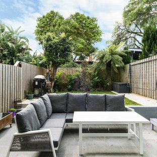 Photo of a small contemporary backyard patio in Sydney with concrete pavers and no cover.