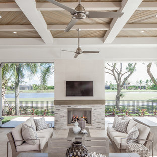 Transitional backyard patio photo in Other with a fireplace and a roof extension
