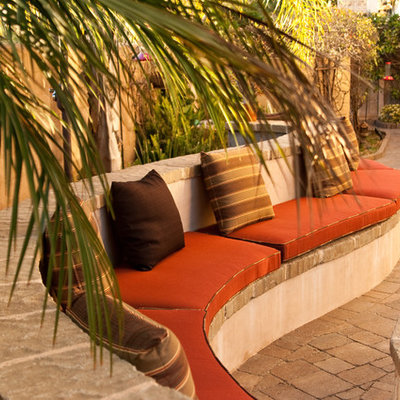 Tuscan concrete paver patio photo in San Diego with no cover
