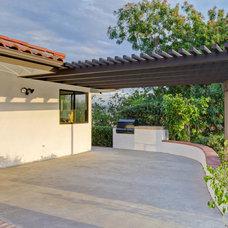 Mediterranean Patio by Legacy Real Estate Ventures, LLC