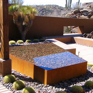 Southwest courtyard patio photo in Phoenix with a fire pit