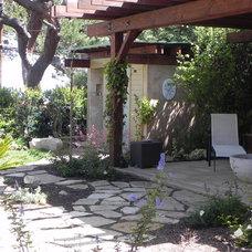 Mediterranean Patio by Poetic Plantings