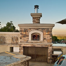 Mediterranean Patio by Fogazzo Wood Fired Ovens and Barbecues LLC