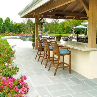 Patio - traditional backyard stone patio idea in San Diego with a gazebo