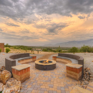 Inspiration for a mid-sized southwestern concrete paver patio remodel in Phoenix with a fire pit and no cover