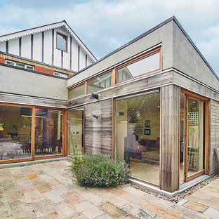 Photo of a contemporary courtyard patio in Dublin with natural stone paving.