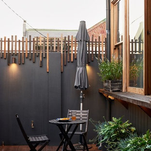 Photo of a contemporary patio in Sydney with a container garden and decking.