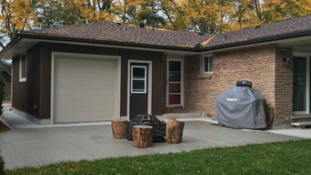 Rear garage addition with new concrete patio area