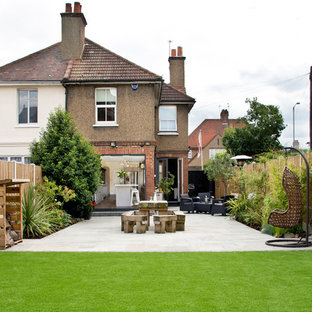 Photo of a contemporary backyard patio in Essex with a vegetable garden, concrete pavers and no cover.