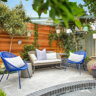 This is an example of a classic patio in London with a potted garden.