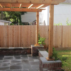 Traditional Patio by Ravenscourt Landscaping and Design LLC