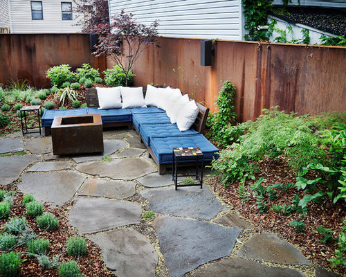 Small Trendy Front Yard Stone Patio Photo In New York