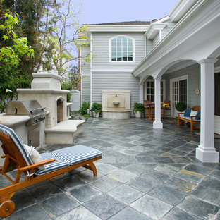 Elegant patio photo in Orange County with a fire pit