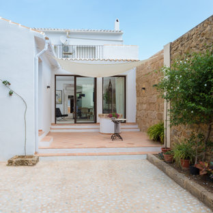 Mediterranean courtyard patio in Alicante-Costa Blanca with tiled flooring and an awning.
