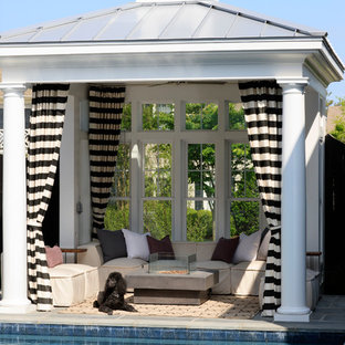 Coastal backyard tile patio photo in DC Metro with a gazebo and a fire pit
