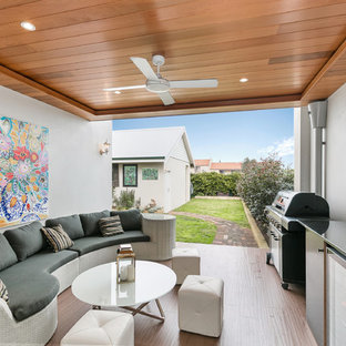 Design ideas for a transitional patio in Perth with a roof extension.