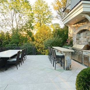 Huge elegant backyard decomposed granite patio kitchen photo in New York with no cover