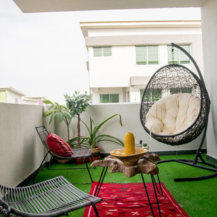 Mid-sized minimalist patio photo in Other