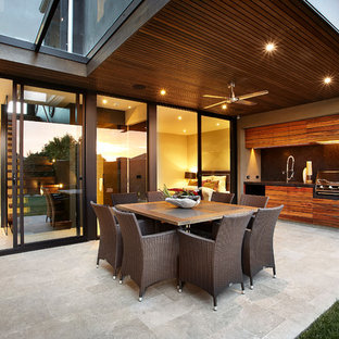 Photo of a contemporary patio in Melbourne with natural stone paving.