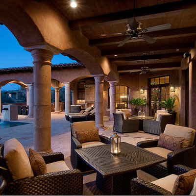 Inspiration for a mediterranean patio remodel in Phoenix with a roof extension