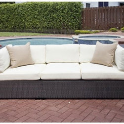 Resort Collection Outdoor Sofa - The Resort Collection outdoor wicker sofa has deep seating cushions. Matching arm chairs and coffee table are also available.