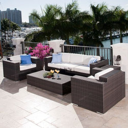 Resort Outdoor Wicker Lounge Chair - The Resort lounge chair has an aluminum frame with a wicker body and deep seating cushions. It is available with a matching sofa and coffee table.