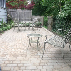 Traditional Patio by Acorn Landscaping and Ponds LLC