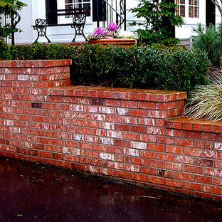 Inspiration for a backyard brick patio container garden remodel in Portland with no cover