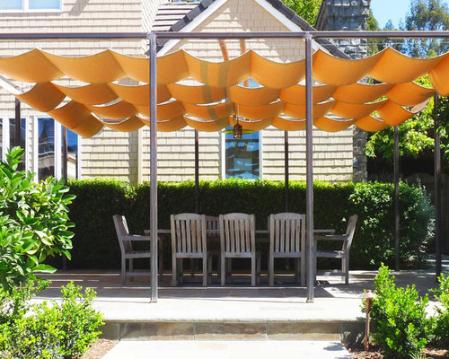 Umbrellas decorating ideas images in patio mediterranean design ideas - Retractable Shade Cloth Houzz