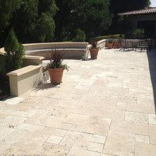 Mediterranean Patio by Element Construction Masonry & Paving