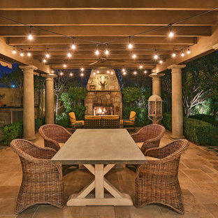 Design ideas for a victorian patio in Santa Barbara with tile and a pergola.