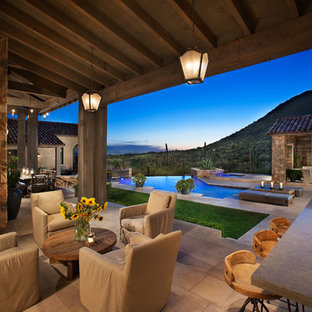 Example of a southwest patio design in Other