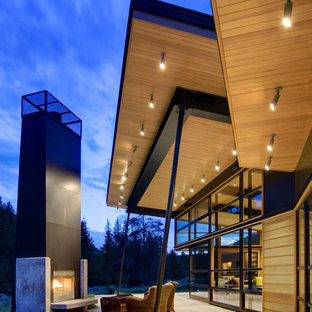 Patio - contemporary patio idea in Seattle with a fire pit