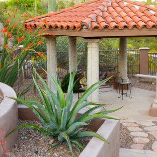 Southwest backyard concrete paver patio photo in Phoenix with a gazebo