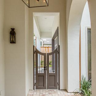 Idee per un grande patio o portico chic