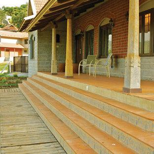 Immagine di un patio o portico etnico
