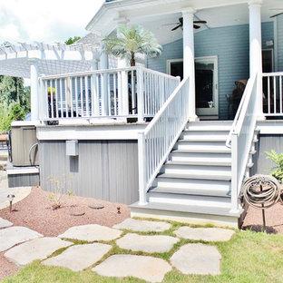 Ejemplo de patio tradicional, grande, en patio trasero y anexo de casas, con fuente y adoquines de piedra natural