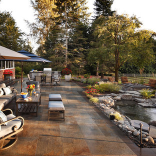 Trendy backyard patio kitchen photo in Seattle