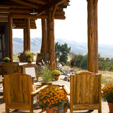 Rustic Patio by Rocky Mountain Log Homes