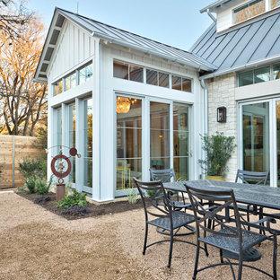 Foto di un grande patio o portico chic davanti casa con nessuna copertura e graniglia di granito