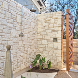 Inspiration for a large transitional courtyard patio in Austin with an outdoor shower and decomposed granite.