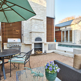 Patio kitchen - large transitional backyard decomposed granite patio kitchen idea in Austin with no cover