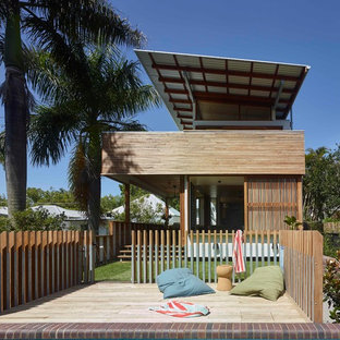 Inspiration for a small contemporary backyard patio in Brisbane with decking and no cover.