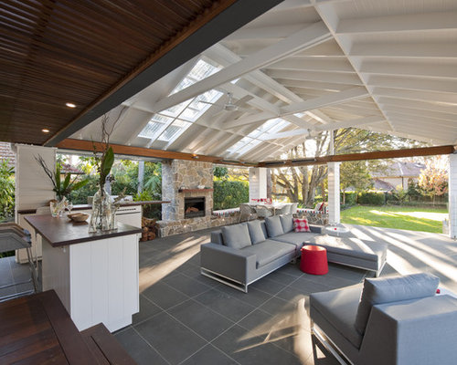 Design Ideas For A Large Contemporary Backyard Patio In Sydney With A Fire  Feature.