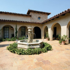 Mediterranean Patio by Steigerwald-Dougherty, Inc.