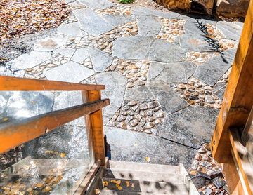 Rundle Stone & River Rock Patio with Rock Retaining Wall Garden