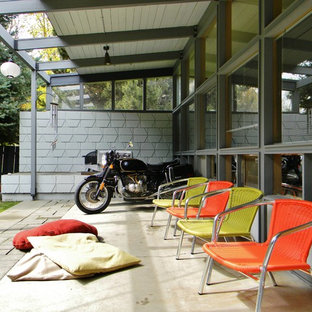Inspiration pour une terrasse vintage avec une extension de toiture.